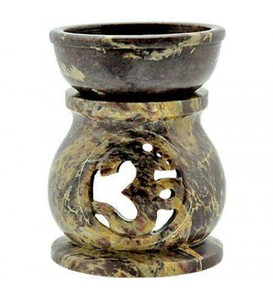 Om Carved Soapstone Oil Burner Lovely soapstone is hand shaped on this oil burner with a carved Om symbol and removable bowl.