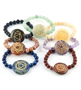 7 Carved Chakra Gemstone Bracelets. This set of 7 Chakra gemstone bracelets are great for meditation or reiki healing.
